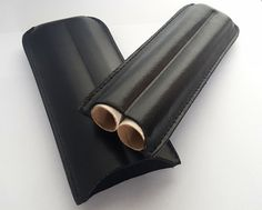 Vintage cigar case made of black genuine leather.  Holds 2 cigars. In very good vintage condition, never used. Please see the pictures for more details.  Measurements: 190 mm x 75 mm x 25 mm (7.48 x 2.95 x 0.98)  Its a great piece to hold cigars and a great gift idea for a smoker or collector of vintage tobacciana.  ******************************************************************************  Please do not hesitate to contact for any further details.  Also please check the shop policies…