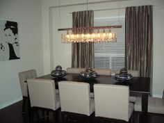 Rectangular crystal chandelier, nice and love the low backs of the chairs