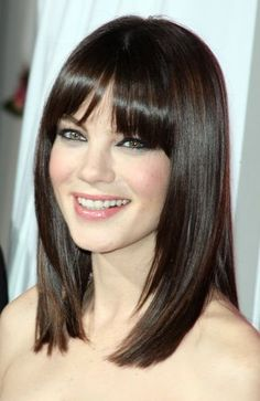 Medium straight haircut with full bangs