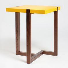Designer Hugo Passos' yellow side table inspired by the paintings of Dutch artist Piet Mondrian will feature in the Stepney Green Design Collection curated by Dezeen.