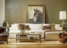 It has become quite acceptable, and even stylish, to display large pieces of framed art behind furniture. Although you may not want to hide half of your favorite piece of art, this may be a good solution if you move and don't have the wall space you had previously.