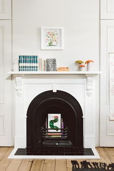 mantel styling + unused fireplace book storage.