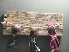 Diy sunglass holder! This is a quick and easy way to keep your sunglasses organized, using cheap supplies. This holder is used with 4 screws, yarn and a block of wood!
