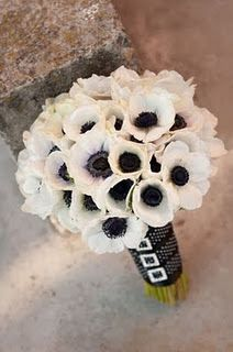 black and white bouquet.  You can stick like one red poppy among the white ones.  Just an idea :P