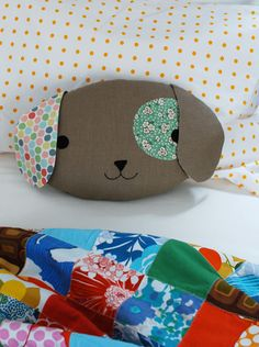Puppy Pillow with Template - MADE...cute template.  FYI for me next time I make this guy...the main body solid color requires more than 1 fat quarter of fabric if also doing ears in this color.