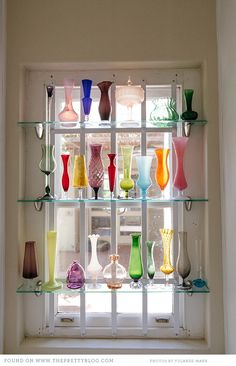 I only pinned this because it reminds me if the window in my late grandmother's house, it is remarkably similar to a display of coloured glass she kept in her window at the bottom of the stairs. Weird feeling of having seen this before.