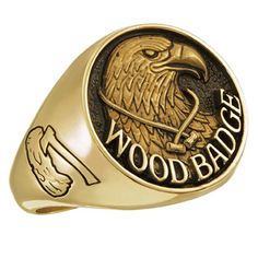 Scouters, celebrate your service with the officially licensed Wood Badge ring.  The ring always features the axe and log on the left side, and the Boy Scouts of America trefoil on the right side. The top of this ring depicts an eagle's head with a necklace and beads around its neck. Standard fit ring is handcrafted to order by ArtCarved.  Available in various metals.