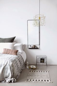 Love the bedding.  Don't like the light fixture or wire rack
