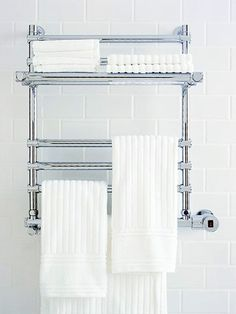 Heated towel racks are great alternatives to radiators in small bathrooms. They act as a heat source plus they're functional for storage. Not to mention their original purpose of keeping your towels warm.