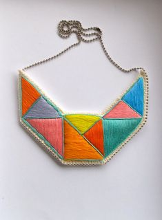Embroidered geometric necklace bib in mint bright yellow pink blue lavender and orange embroidered triangles dramatic design. $65.00, via Etsy.