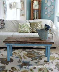 A skinny bench (this one was a lucky find at a garage sale) is the perfect solution for a narrow conversation space. Click through for more unique coffee table ideas.