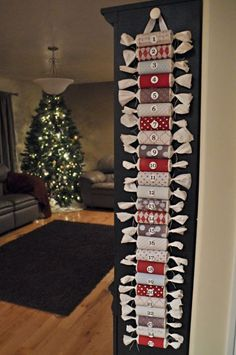 Advent Calender: Toilet paper rolls, Holiday paper or scrap book paper, tissue paper to place candy inside each roll, wide ribbon for hanger.