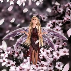 fairy girl walking among flowers