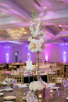 LED Lights make this wedding truly pop!   And those centerpieces... absolutely amazing.