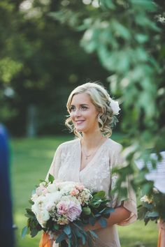 Pretty from the front with the peony  peeking from the back ~ we ❤ this! moncheribridals.com