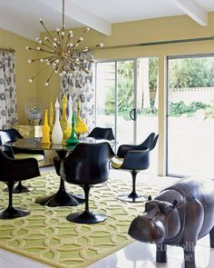 Palm Springs living room, Saarinen chairs,  rug, mixed bottles and hippo!