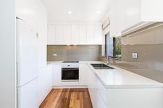 White Polyurethane Kitchen with Glass Splashback Custom Kitchens, Splashback, Glass Kitchen, Joinery, Kitchen Cabinets, Home Decor, Carving, Woodworking, Decoration Home