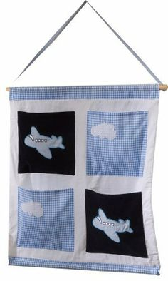 Snuggle Sac Little Plane 100% Cotton Wall Tidy by Snuggle Sac. $32.00. Can be moved from room to room. Great for storing small items. 100% Polyester Outer; 100% Cotton Lining. 4 other items to match to create a co-ordinated room. Matching Snuggle Sac; Bed Tidy; Wally Tidy and Laundry Bag. Beautiful Navy Star Cotton Wall Tidy with 4 storage pockets to hang on the wall. This can be purchased separately or as part of a set of 5 matching items.