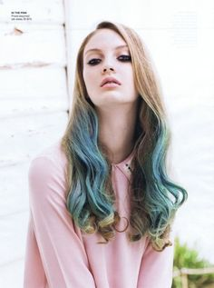 Cute hair idea, adding some turquoise to the front ends of long naturally colored hair.