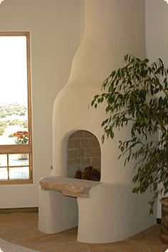 Google Image Result for http://www.kivafireplaces.com/images/Traditional-Kiva-Fireplace.jpg