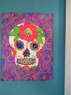 rainbow sugar skull, ouline with wool. acrylic on canvass, with added gems