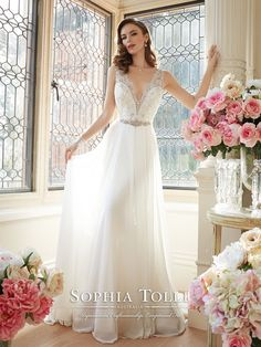 Sophia Tolli Y11633 – Augusta - Sleeveless angel chiffon slim A-line wedding gown, lace trimmed shoulder straps and plunging V-neckline subtly conceal sweetheart hand-beaded lace appliqué bodice with beaded natural waist, semi sheer V-back with lace appliqués and back zipper both trimmed with diamante buttons, top layer of chiffon skirt features center front split, chapel length train.