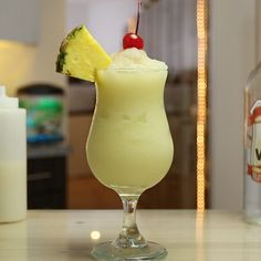 Who doesn't love a tropical cocktail like this slushy, creamy Chi Chi?This beachy mixed drink combines vodka, pineapple juice, and cream of coconut, and is garnished with pineapple wedges and a cherry for some extra vacation drink vibes. Vodka Cocktails, Non Alcoholic Drinks, Fun Drinks, Yummy Drinks, Beverages, Cocktail Mix, Cocktail Drinks, Cocktail Recipes, Tropical Mixed Drinks