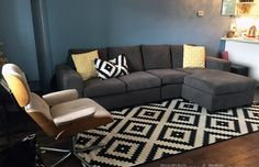 Growing to LOVE this living room day by day!   Rug: IKEA, Couch: Leons, Yellow Throw PIllows: Bouclair, Black & White Throw Pillow: IKEA, Chair: Vintage, Coffee Table: Missing Legs :(