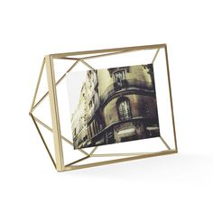 Capture the memories that are closest to your heart with the Gem Photo Frame. Stunning brass is fashioned into the shape of an intricately cut gem, giving your photos a backdrop that only enhances the ...  Find the Gem Photo Frame - 4x6, as seen in the Dark & Stormy Modern Collection at http://dotandbo.com/collections/dark-and-stormy-modern?utm_source=pinterest&utm_medium=organic&db_sku=UMB0159