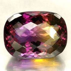 Ametrine is one of the world's most unusual gemstones in that it is actually two gems in one! Ametrine blends the golden sunburst of Citrine with the purple sunset of Amethyst.