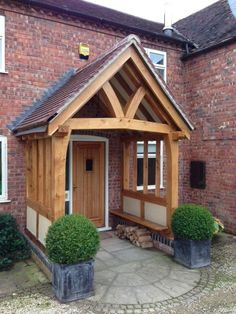 An open oak framed porch with shaped tie beam and shaped front posts. Render panels in the side and an oak seat.