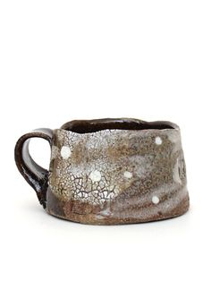 Handmade stoneware mug with hand crafted glazes and a delicate constellation pattern based on Hubble telescope images and star charts. One-of-a-kind work of art. Handwash. Made in Michigan. (via Jake Vinson Mug - Constellation #3 « Pour Porter)