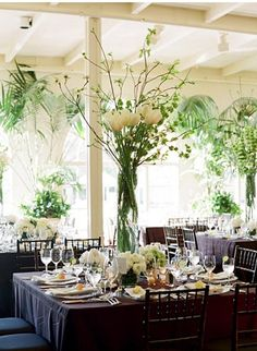 Bells of Ireland, dogwood branches, & tulips. Simple arrangement for a party with tall ceilings.