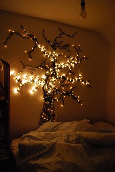 a tree with lights on the wall...love it...very cool