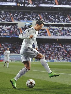 Real Madrid's Ronaldo doing a step over the soccer ball.