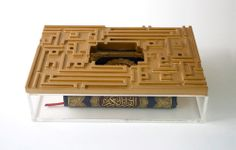 Kashida Design - 3D Arabic Calligraphy - A clear acrylic box with a golden wooden top, this piece stores the Holy Quran in a contemporary, elegant fashion.