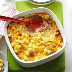 Ham & Cheese Potato Casserole Recipe -This recipe makes two cheesy, delicious casseroles. Have one tonight and put the other on ice for a future busy weeknight. It's like having money in the bank when things get hectic! —Kari Adams, Fort Collins, Colorado