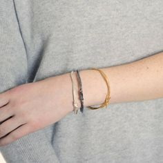 These bangles look best worn layered together in different finishes. LOOPED STRING BANGLE - from £120.