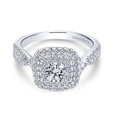 This thrilling engagement ring features a pair of pavé diamond halos looped around a round cut center stone atop a band of criss crossing diamond ribbons. * Setting only - center diamond sold separately Double Halo Engagement Ring, Engagement Jewelry, Diamond Engagement Rings, Gold Jewelry Simple, Fashion Rings, Fashion Jewelry, White Gold Diamonds, Wedding Rings, Gabriel