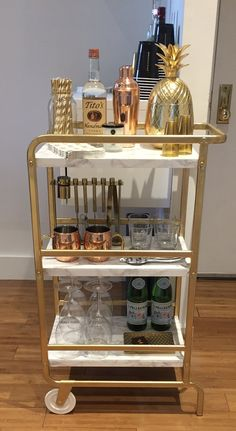 It's an illuminated bar - IKEA hackersAnother great bar hack! It's an illuminated bar - IKEA hackersIKEA Hack: Gold & Marble Bar CartIKEA Hack: Gold & Marble Bar Cart by Twinspiration: Bar Ikea, Ikea Bar Cart, Diy Bar Cart, Gold Bar Cart, Bar Cart Decor, Bar Cart Styling, Bar Carts, Bar Trolley, Drinks Trolley Ikea
