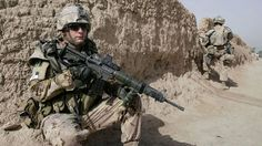 A Canadian soldier takes a position during a patrol in Arghandab, a district of Kandahar province, on July 6, 2008. Canada's combat mission ends in 2011 and a greatly expanded training mission will replace it. Allauddin Khan/Associated Press