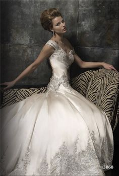 I love this...the drop waist and the embellishment. But I would like it better completely strapless with the sweetheart neckline
