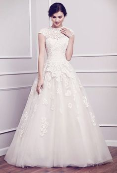 Brides: Kenneth Winston. A classically-inspired look with the use of cotton lace build up finished with a ball gown skirt. Zipper back.