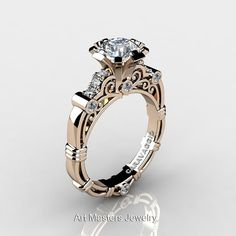 Elegant, luxurious and rich, this Art Masters Caravaggio 14K Rose Gold 1.0 Ct White Sapphire Diamond Engagement Ring R623-14KRGDWS is sure to delight