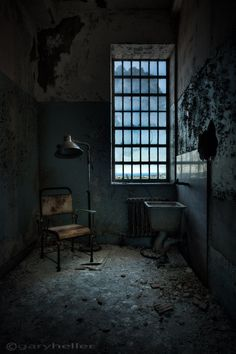 the private room - 8x12 fine art photography print of a small room in an abandoned asylum lit by ethereal window light revealing contents.. $49.00, via Etsy.