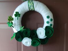 St. Patrick's Day Wreath with Eco-Friendly Felt Flowers, Shamrocks and St. Patrick's Day Ribbon - 12 Inch Yarn Wrapped. $35.00, via Etsy.