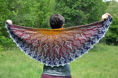 This particular yarn gradient immediately evokes a gorgeous sunset and a half-circle shawl is the perfect form to capture it. The rays of this sun twist and curve in art nouveau-esque patterns as they fade into the blusih-purple of the night sky.