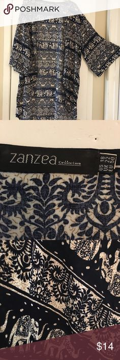 ❄️SALE❄️💟ZANZEA Cute Elephant Kimono💟 ⭐️Cute kimono. Elephant print. Navy blue in color. No information about material. Material doesn't stretch. I would say it's polyester/rayon blend. zanzea Tops