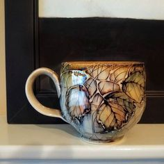 Tried a slight variation on a bramble mug- very pleased with the result.Canadian potter.