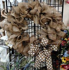 "Burlap ruffle wreath with polka-dot bow. Supplies: Burlap mesh 12x10"", chenille stems, wire form, ribbon Designer: H Cooper"
